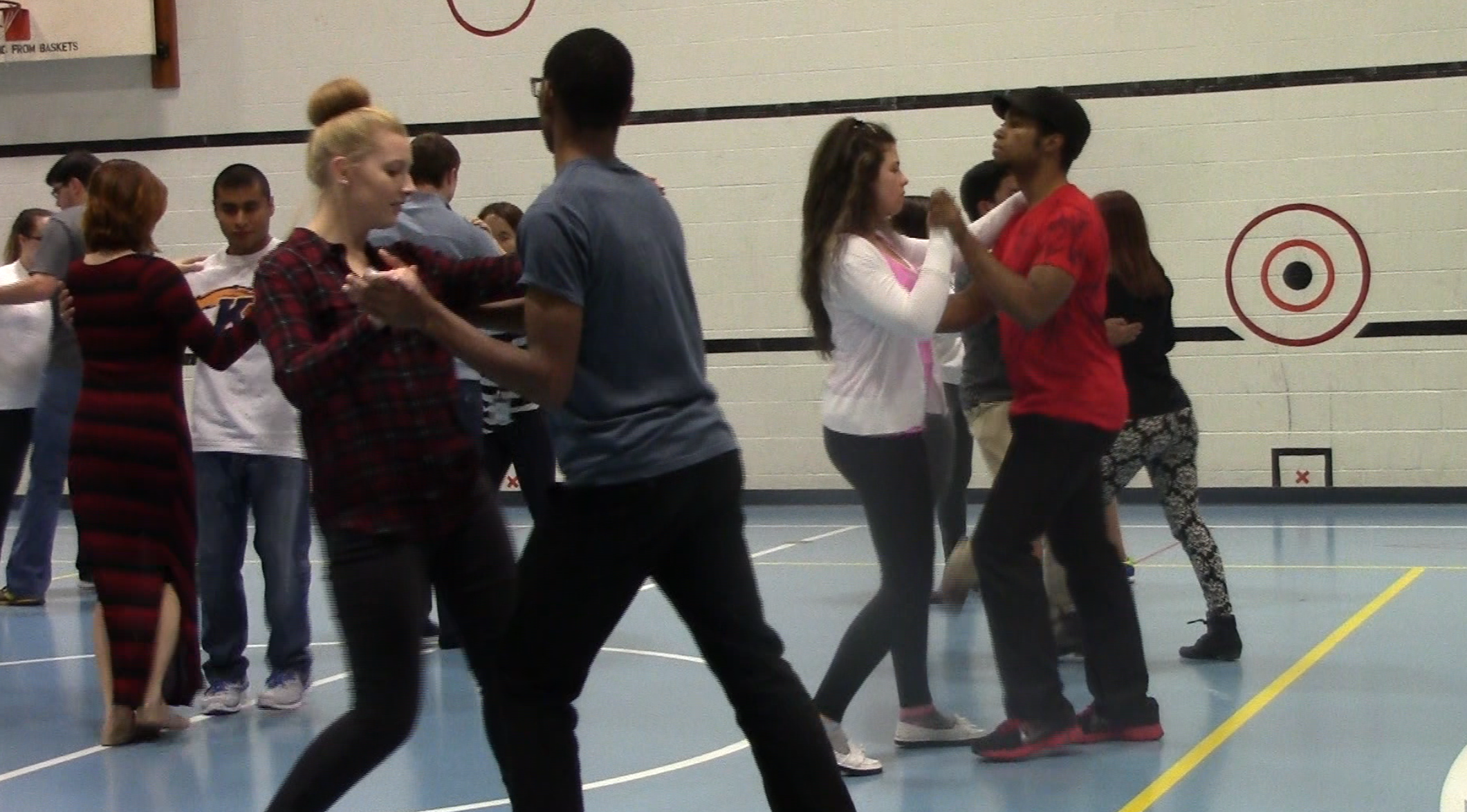Students dance to a song by Rhianna during their ballroom dancing class.