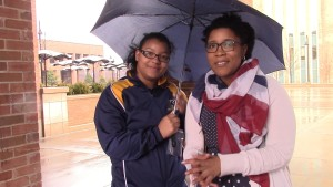 Sydney Jordan(right), is seen near the Student Center at Kent State University Tuesday morning after handing out free umbrellas to students